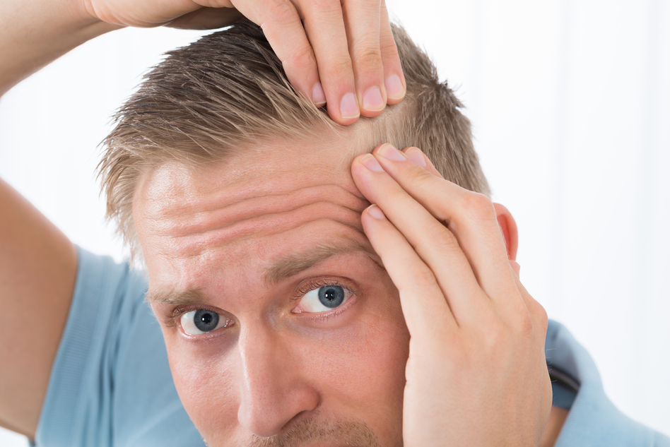 man examining his hair